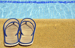 Women's sandals on the feet of the pool Stock Image