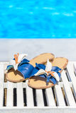Women's sandals with a flower on the edge of the swimming pool Stock Photography