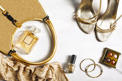 Women's set of fashion accessories in golden color Stock Images