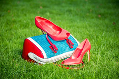 Women's shoes are on the bag and on the ground, women's summer shoes Stock Photo