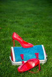 Women's shoes are on the bag and on the ground, women's summer shoes. A Stock Photo