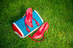 Women's shoes are on the bag and on the ground, women's summer shoes. A Royalty Free Stock Photo