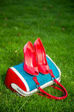 Women's shoes are on the bag and on the ground, women's summer shoes. A Royalty Free Stock Photography