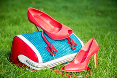 Women's shoes are on the bag and on the ground, women's summer shoes. A Royalty Free Stock Photos