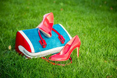 Women's shoes are on the bag, women's summer shoes. Women's shoes are on the bag and on the ground, women's summer shoes Royalty Free Stock Photos