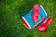 Women's shoes are on the bag, women's summer shoes. Women's shoes are on the bag and on the ground, women's summer shoes Royalty Free Stock Photo