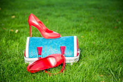 Women's shoes are on the bag, women's summer shoes. Women's shoes are on the bag and on the ground, women's summer shoes Stock Images