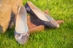 Women's shoes, ballet flats on grass, military style. A Stock Image