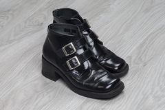Women`s shoes black patent leather. With metal buckles royalty free stock image