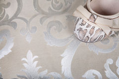 Women's shoes with a bow on a background of vintage fabric close Stock Image