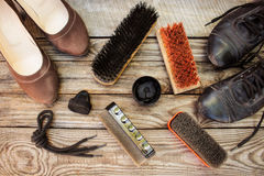 Women's shoes and care products for footwear on wooden background. Royalty Free Stock Photography