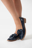 Women's shoes. Girl's legs in shoes Stock Photos
