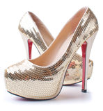 Women's shoes with gold sequins Stock Photos