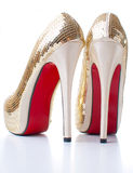 Women's shoes with gold sequins Stock Photo