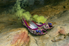 Women`s shoes with green smoke Stock Photos