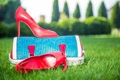 Women's shoes on the ground, women's summer shoes. Women's shoes are on the bag and on the ground, women's summer shoes Stock Photo