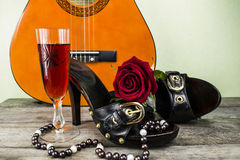Women's shoes and a guitar Royalty Free Stock Photography
