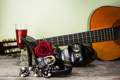 Women's shoes and a guitar Royalty Free Stock Photo