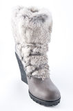 Women's shoes on a high platform sole with fur trim. 