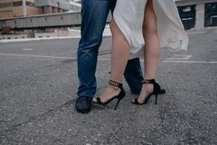 Women's shoes on the legs of a woman stock photography
