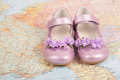 Women`s shoes on map Royalty Free Stock Image
