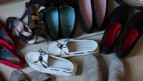 Women`s shoes are placed on the floor, close-up