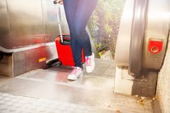 Women`s shoes going up on the escalator outdoors Stock Image