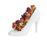 Women's shoes and roses. White women's shoes and red roses. still life royalty free stock photo