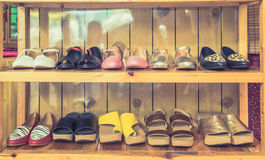 Women's shoes on shelves made of wood. stock image