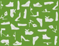 Women's Shoes. Shoe sillhouettes against a plain green background Royalty Free Stock Image