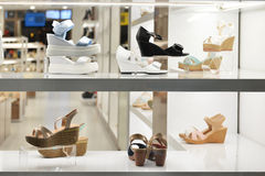 Women's shoes  shop window. Women's shoes on the shelf in the shop window Stock Photos