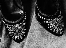 Women`s shoes in stones Royalty Free Stock Photography
