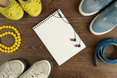 Women`s shoes, yellow beads, blue belt, black headphones and whi Royalty Free Stock Photos