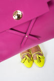 Women's shoes. Yellow female shoes with a pink bag Royalty Free Stock Photography