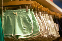 Women's shorts hanging in trendy boutique Stock Photography