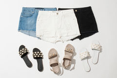 Women`s shorts and sandals collection. Set from women`s shorts and sandals on white background Stock Photo