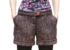 Women's shorts from wool tweed with hands in pockets closeup. Royalty Free Stock Photography