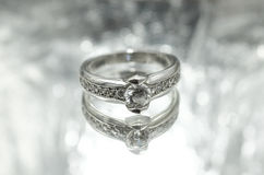 Women's silver ring with a diamond Royalty Free Stock Images