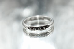 Women's silver ring with a diamond Stock Photography