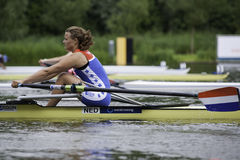 Women's Single Sculls. Bosbaan, Amsterdam, the Netherlands - 22 July 2011:  Nicole Beukers during the start of the Women's Single sculls repechage 2 during the Stock Photo
