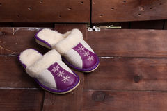 Women's slippers on sheep's wool. Royalty Free Stock Photography