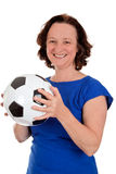 Women's soccer. Mature adult woman holding a soccer ball - isolated on white Royalty Free Stock Photo