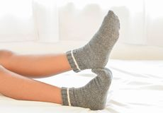Women`s socks on bed. Women`s socks Beautiful feet and skin health on bed royalty free stock image