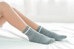 Women`s socks on bed. And fashion royalty free stock photography