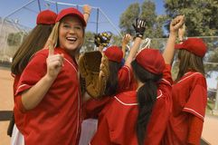 Women's softball team celebrating Stock Photography