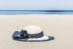 Women's straw hat on the beach. Women's straw hat on the beach, close up Stock Photos