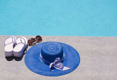 Women's stuff by the swimming pool Royalty Free Stock Image