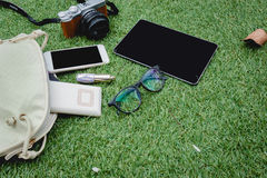 Women's stuffs are on green grass.  Stock Photography