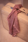 Women's Suitcase with Pink Scarf Stock Photo