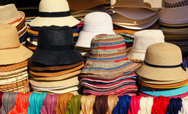 Women`s summer hats and scarves at the street market Stock Image